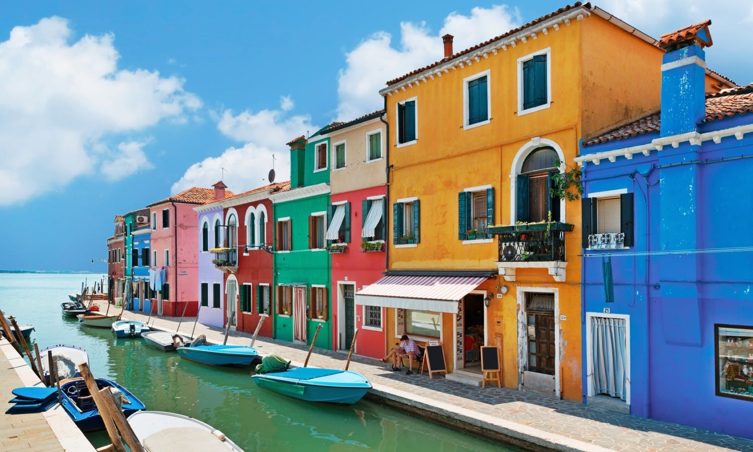 colorful houses by the water canal at the island Burano © pitrs_Fotolia_71280783.jpg