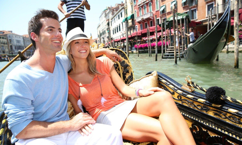 Couple in Venice having a Gondola ride on canal grande_Fotolia_53631928.jpg