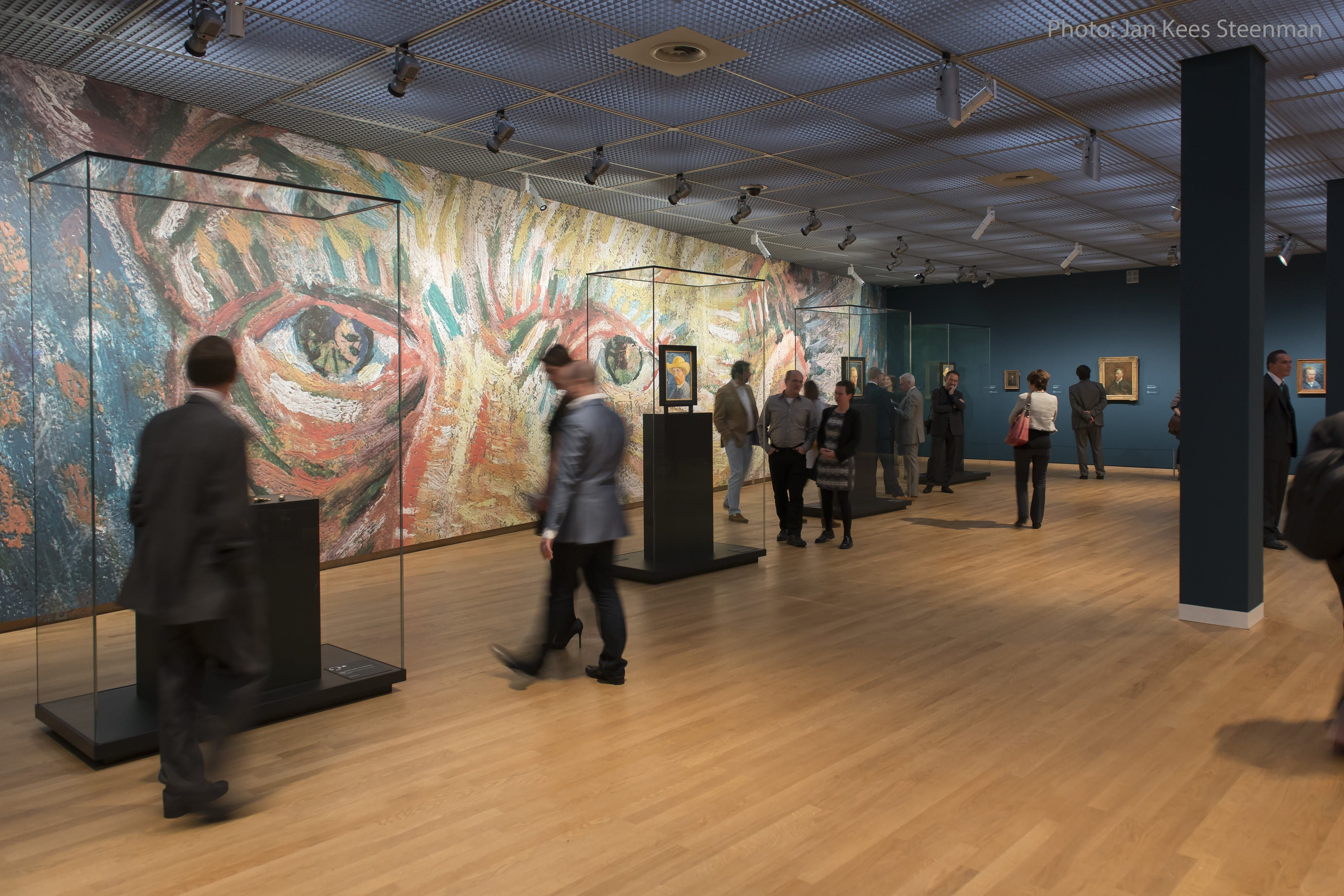 Van Gogh with photo credits inside museum with vitrines