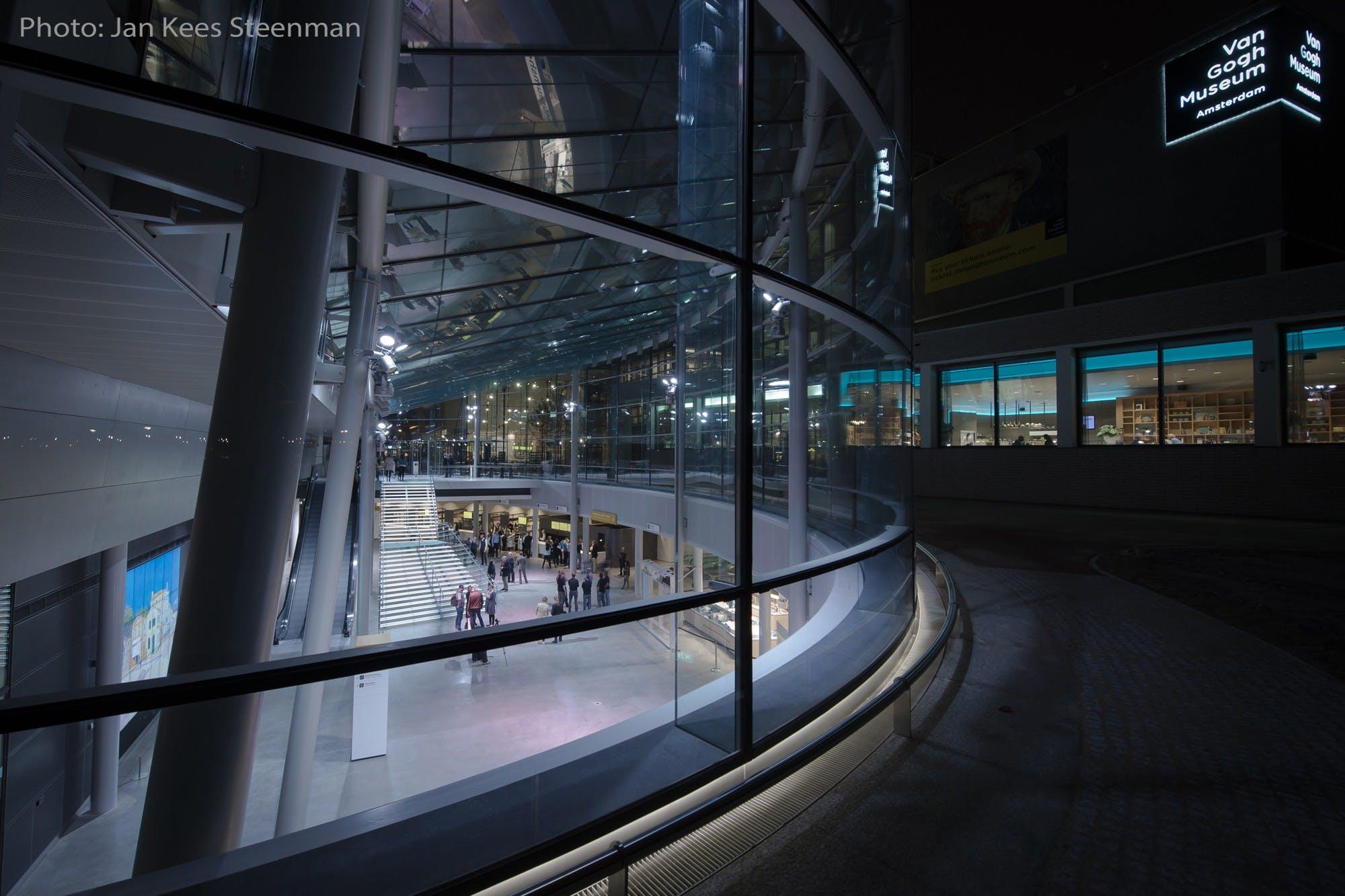Van Gogh with photo credits museum entrance at night
